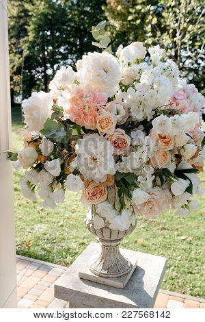 Big Peach Bouquets On The White Stands On The Wedding Outdoor Ceremony