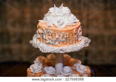 Wedding Cake Orange With White Flowers Of Sweet Cream