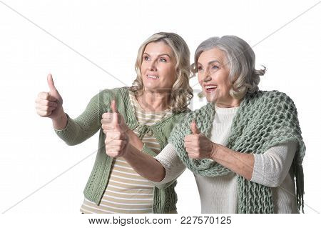 Portrait Of Two Smiling Women  Isolated On White Background