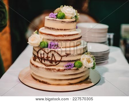 Sweet Wedding Cake With Tiers Decorated With Fresh Flowers