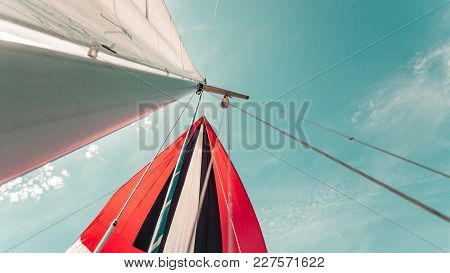 Spinnaker With Uphaul On Sail Boat, Blue Sky In Background. Marine Sailing Objects Concept.