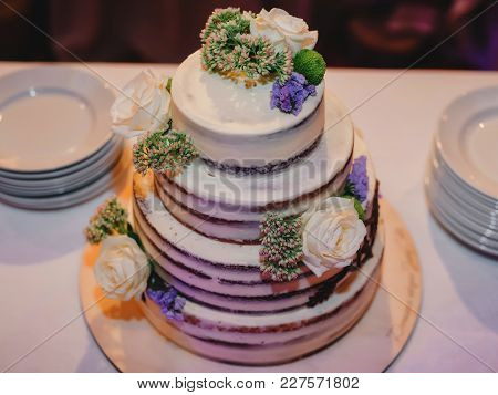Wedding Cake With Tierwedding Cake With Tiers Decorated With Flowers On The Tables Decorated With Fl