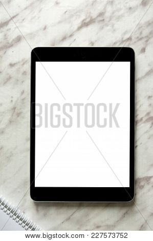 Empty Generic Tablet Pc On Top Of White Marble, Vertical