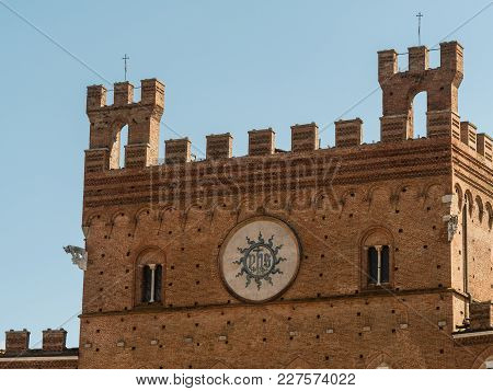 View On The Upper Part Of The Facade Of The Palazzo Pubblico At The Piazza Del Campo In Siena, Italy