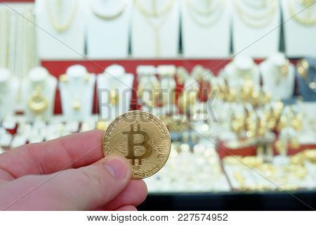 Bitcoin Payment For Jewelry At A Jewel Shop Using Cryptocurrency In Real Life Concept