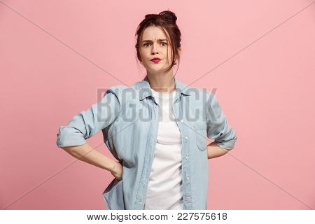 Angry Woman Looking At Camera. Aggressive Business Woman Standing Isolated On Trendy Pink Studio Bac