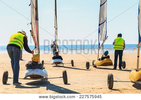 Saint Jean De Monts, France - September 23, 2017 : Group Of People Taking A Lesson Of Sand Yachting