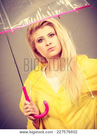 Rainy Autumn Day Accessories Ideas Concept. Woman Having Serious Face Expression Holding Clear Trans