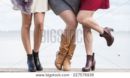 Three Unrecognizable Fashionable Women Wearing Stylish Shoes Outdoor. Boots Perfect For Autumn And W
