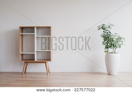 Scandinavian Commode On White Background With Flower In With Pot