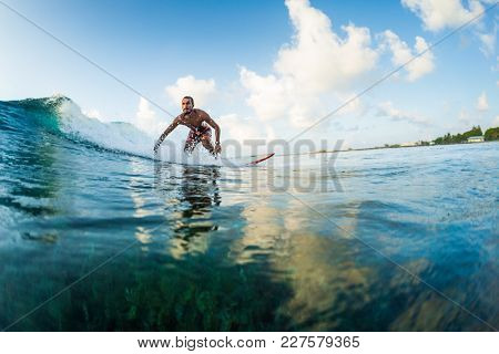 Surfer rides the wave. Extreme sport and active lifestyle concept