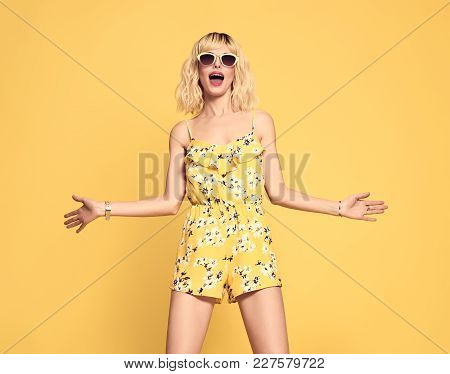 Portrait Of Surprised Young Woman Open Mouth. Fashionable Female Blond Model Girl Jumping Having Fun