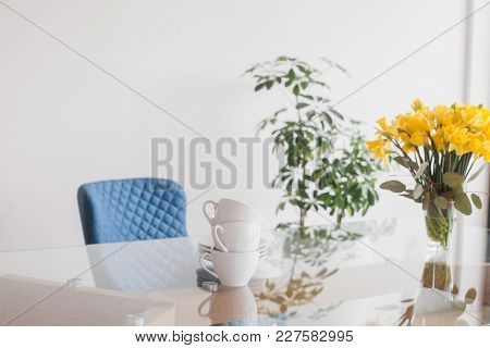 Glass Table Top With Cups, Spring Bouquet And Blue Chair