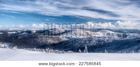 Scenery Of Winter Mountains With Snow Covered Hills And Blue Sky With Clouds From Hala Na Malej Racz