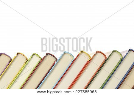 Row Of Colorful And Slanted Books Isolated On White
