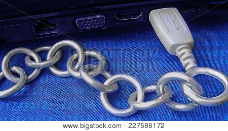 Blockchain Technology Is Shown As A Real Metal Chain Joined By Usb To A Computer. Blue Background Co