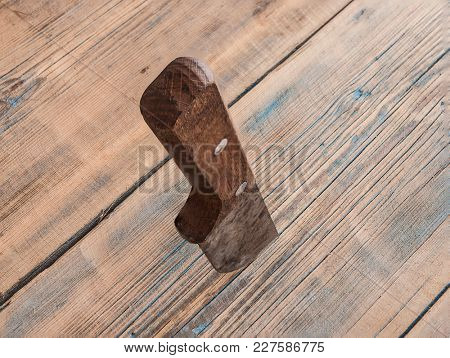 old knife stuck in a wooden table