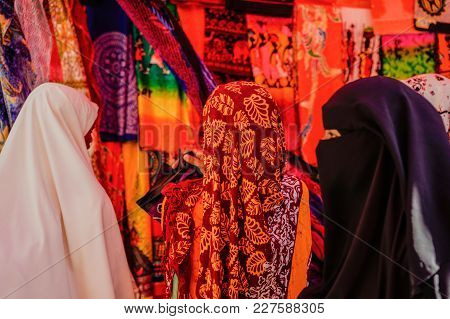 Three Women Shopping At The Market In Stonetown, Zanzibar