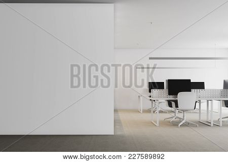 Modern White Office Interior With White Walls, Panoramic Windows And White Computer Tables. A White
