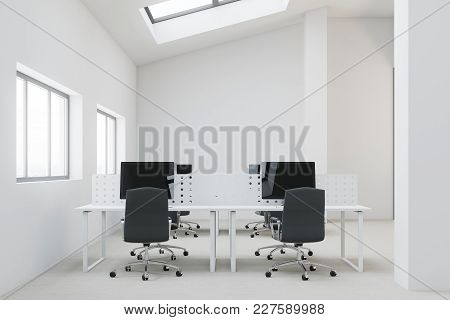 White Penthouse Open Space Office Interior With A Concrete Floor, Computer Desks And Windows In The