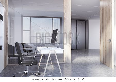 White Open Space Office Corner With A Small Computer Desk, An Office Chair, A Concrete Floor And Woo