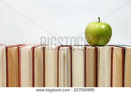 Stack Of Books And Apple On The Table