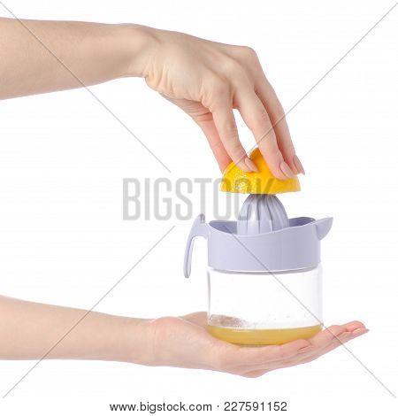 Juicer Lemon Juice In Hands On White Background Isolation
