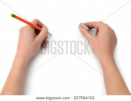 Hand Draws With A Pencil On White Paper