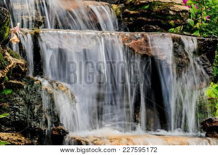 Rocks With Artificial Waterfall On The Territory Of Hotel At Resort