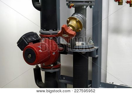 Red Circulation Pump And A Balancing Valve On The White Background