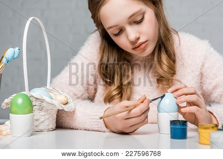 Beautiful Focused Teenage Girl Painting Egg For Easter