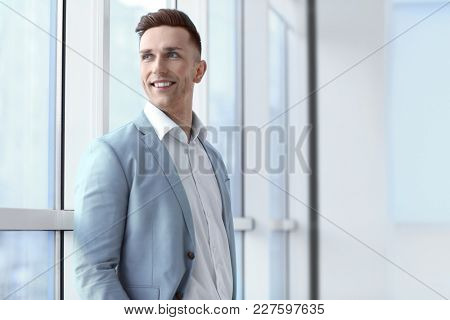 Portrait of young man in office. Small business owner