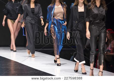 Female Models Walk The Runway In Different Dresses During A Fashion Show. Fashion Catwalk Event Show