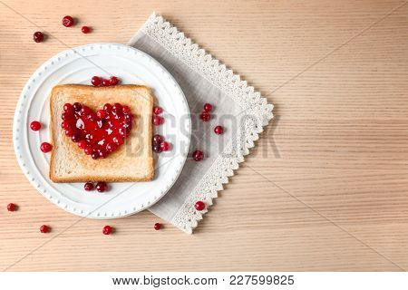Delicious toast with sweet jam on plate