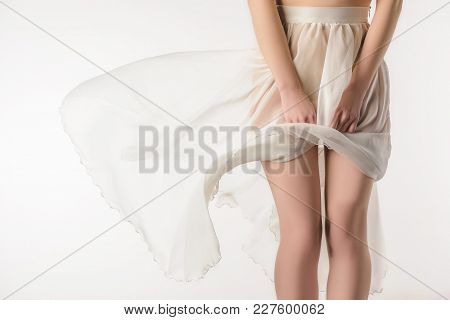 Cropped View Of Sensual Girl In Transparent Waving Skirt, Isolated On White