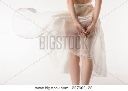Cropped View Of Sensual Naked Girl In Transparent Chiffon Skirt, Isolated On White