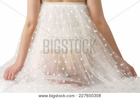 Back View Of Girl With Naked Buttocks In Transparent Chiffon Dress, Isolated On White