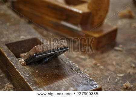 Plane And Shavings In The Woodworking Workshop