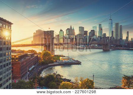 Retro style New York Manhattan with Brooklyn Bridge and Brooklyn Bridge Park in the front.