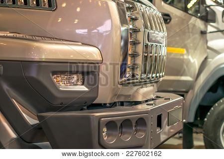 Shiny Chrome Grille Trucks Standing One Behind The Other