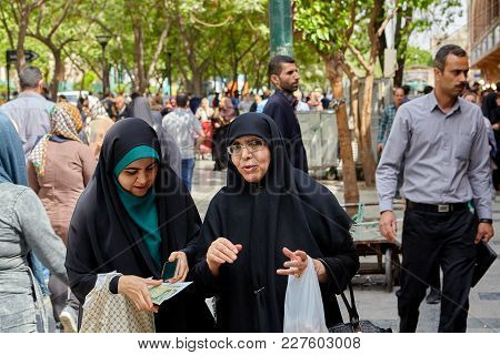 Tehran, Iran - April 29, 2017: Young And Elderly Women, Dressed In An Islamic Religious Veil, Talk I