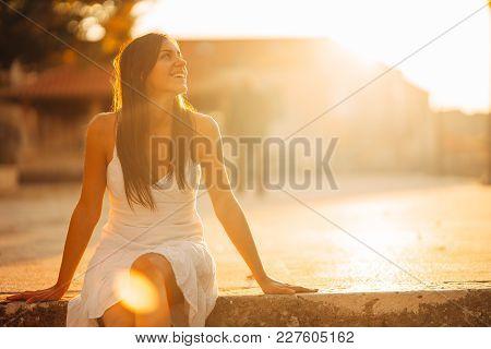 Carefree woman enjoying in nature,beautiful red sunset sunshine.Finding inner peace.Spiritual healin