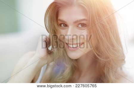 closeup portrait of a smiling young woman with light make-up