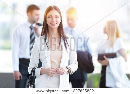 portrait of successful business woman on blurred background office