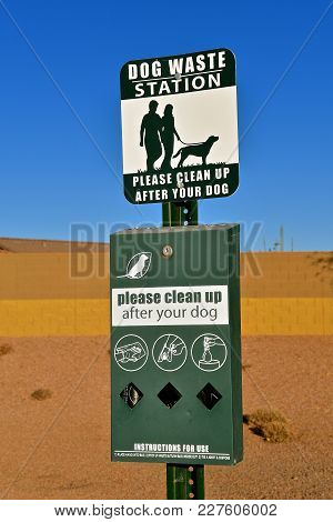 A Dog Waste Station With Signs, Instructions, And Materials.