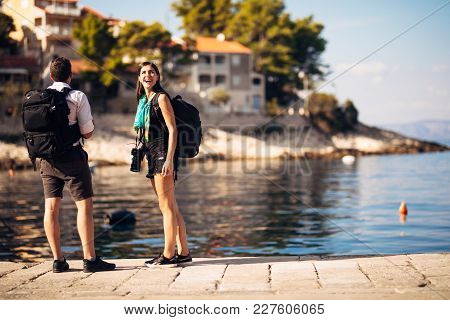 Young Freelancing Photographers Enjoying Traveling And Backpacking.photojournalism.documentary Trave