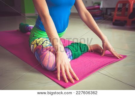 young woman practice yoga indoor shot  closeup extension of lower limbs