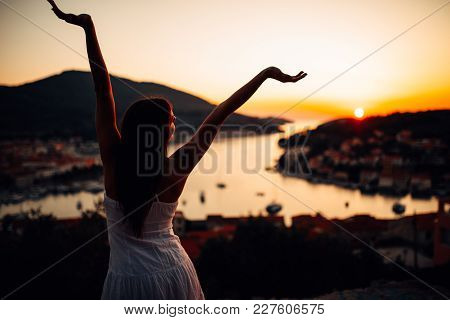 Carefree Woman Enjoying In Nature,beautiful Red Sunset Sunshine.finding Inner Peace.spiritual Healin