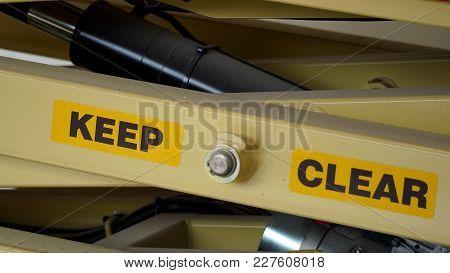 A Scissor Lift Warning Sign, Keep Clear