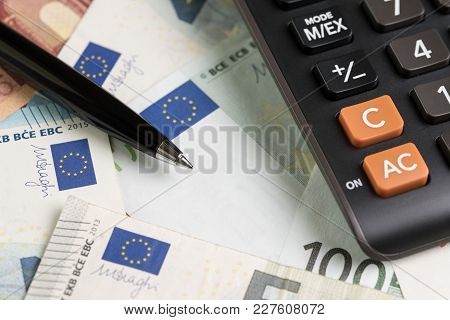 Business Banking, Accounting Currency Concept, Black Pen On Pile Of Euro Banknotes With Calculator,
